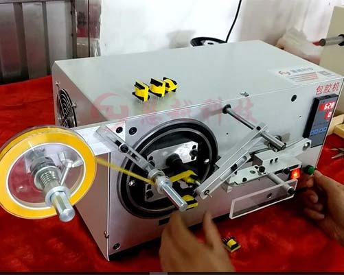 自动铁芯包胶带机